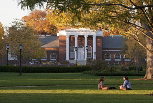Students relaxing outside on the south green