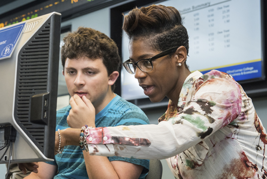Two students working together at a computer