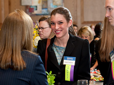 An HBM student at a networking event.