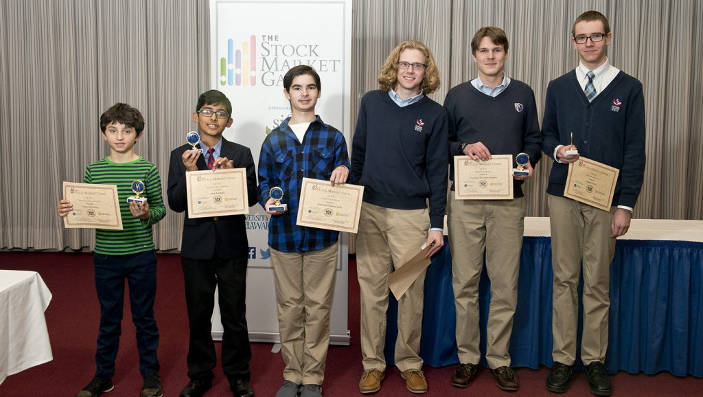Winners of the fall 2018 Stock Market Game Chase McGinley, Sean Kennedy, Anthony Stidham-Mills, Daniel Davis, Shaun Huebler and Christian Newman-Sanders stand together at the awards ceremony.