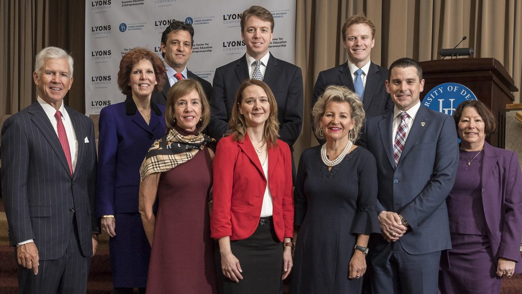 Representatives of the CEEE and Lyons Companies pose with the speakers and moderators of the 2019 Economic Forecast.