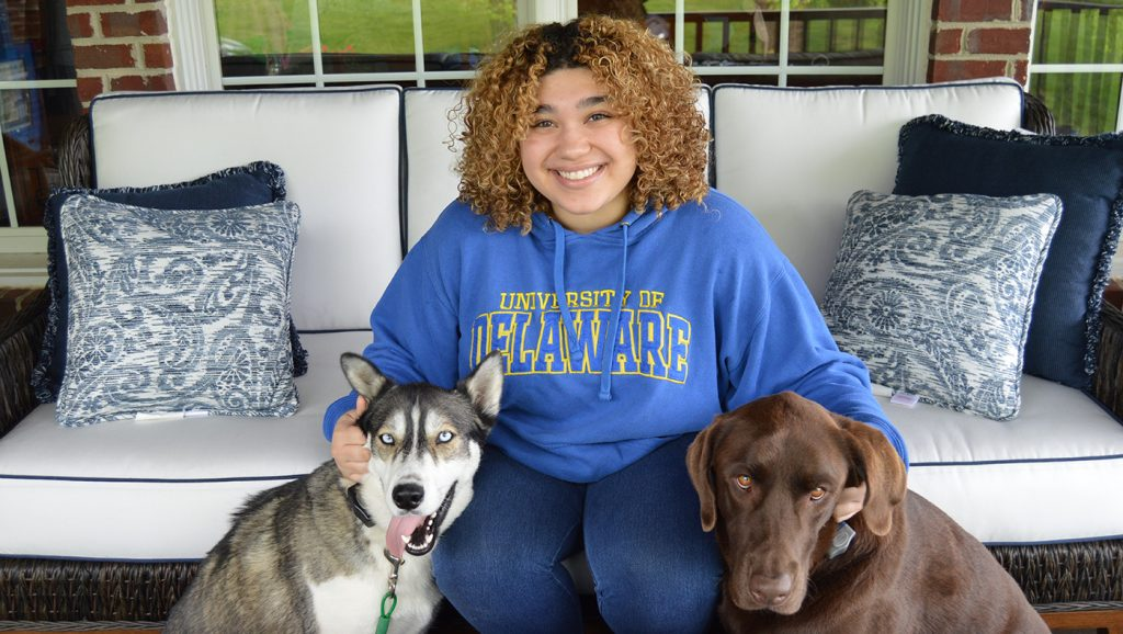 Caitlyn Fernandes poses with her dogs