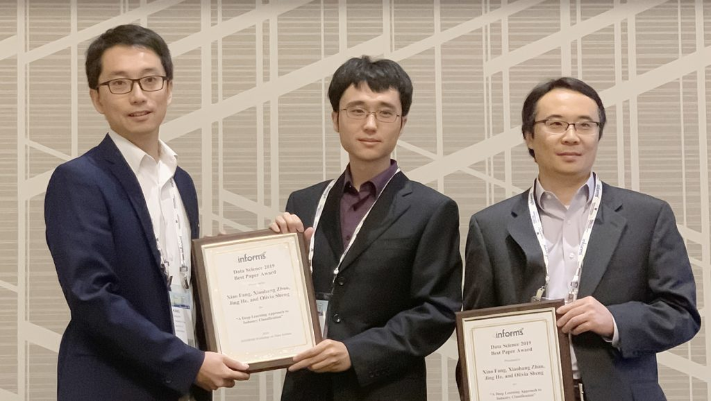 FSAN paper authors hold best paper awards
