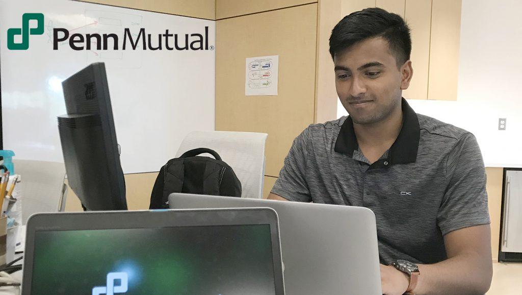 Nishant Chintala, works at his computer as a business transformation intern at Penn Mutual.