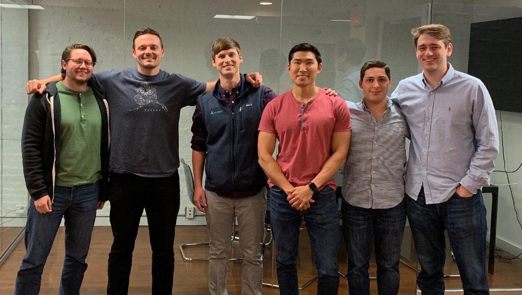 Several Lerner alumni now work at LendEDU and pose smiling at the camera